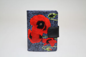 The Red Poppy in front of Black Tapestry